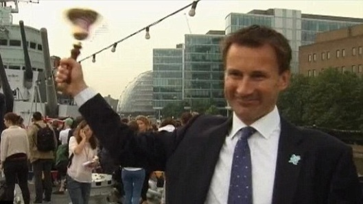 Ringing the changes: Jeremy Hunt, pictured a split-second before events proved there are TWO bell-ends in this image.