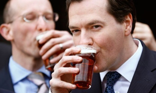 Get it down you: George Osborne's trying to be 'one of the boys' in this photo, but you'll need a stiff drink when you hear what he has in store for the country (even if it is only likely to last one month)!