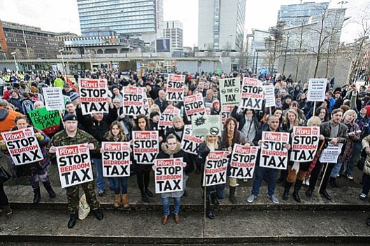 Falling on deaf ears: The chorus of protest against the bedroom tax is unlikely to be heard at the Conservative Party Conference in Manchester, where delegates will be discussing how to bribe the electorate into supporting them in 2015. [Picture: Matthew Pover in the Sunday People]