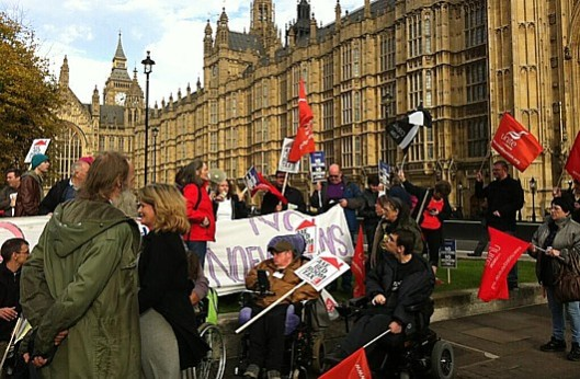Demonstrating for justice: Campaigners against the Bedroom Tax gathered outside Parliament while MPs debated it inside.