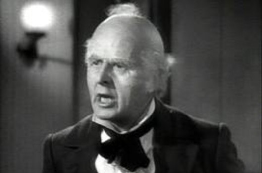 Reginald Owen as Iain Duncan Smith in 'A Christmas Crisis-loan'.