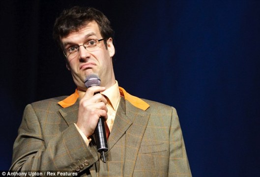 This is the first pic I could find of Marcus Brigstocke, as he might have looked while delivering the piece quoted below. He's a known beardie so he probably had face-fuzz as well.
