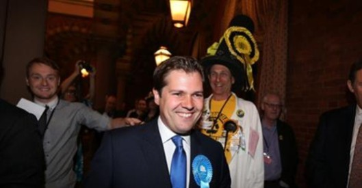 The result: The Tory who won is so unremarkable that I've forgotten his name. More interesting is the chap in the big hat behind him; at first I thought he was the Monster Raving Loony candidate, but it seems more likely he's one of the voters.
