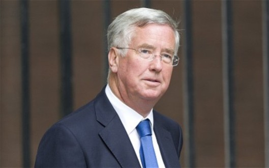 A waste of taxpayers' money: This is Tory business minister and twit Michael Fallon. The amount of money his 'red tape' cuts have cost this country mean he should be behind bars, not in front of them.