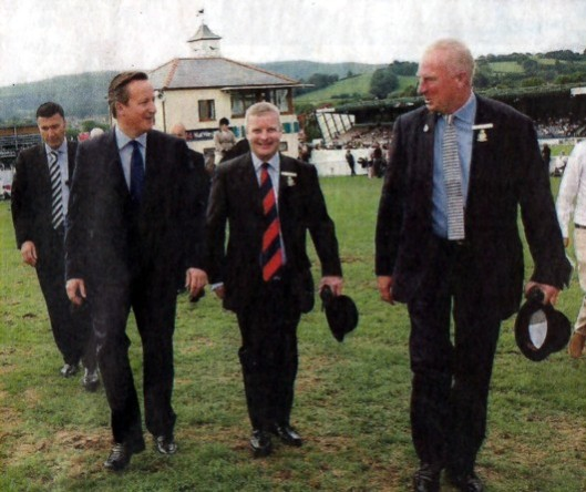David Cameron and Tory election candidate Chris Davies: A suit full of hot air next to a suit full of nothing at all.